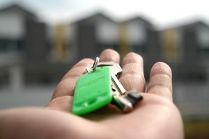 Person holding keys to new house